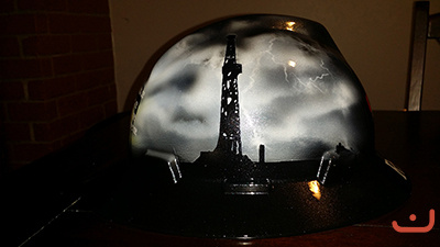 custom oilfield hard hat derrick in storm