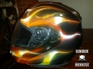 True flames helmetCustom real flames painted motorcycle helmet.  All airbruhed by hand for a very nice flame job that really pops in the light.